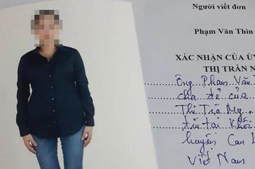 Lá đơn của ông Phạm Văn Thìn đính kèm ảnh con gái Phạm Thị Trà My. Ảnh: Đức Hùng