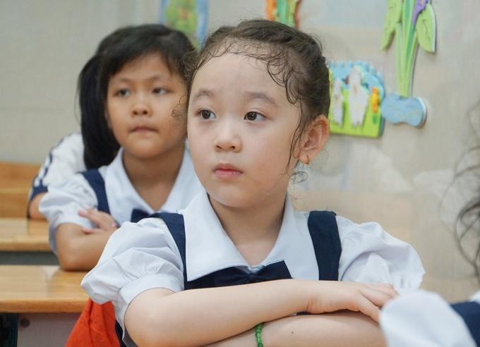 Học sinh trường Tiểu học Mê Linh, quận 3 (TP HCM), đi học ngày 11/5. Ảnh: Mạnh Tùng