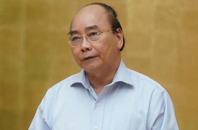 Thủ tướng Nguyễn Xuân Phúc chủ trì họp Thường trực Chính phủ về phòng chống Covid-19, sáng 15/5. Ảnh: VGP