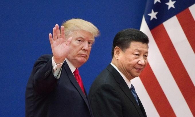 Tổng thống Mỹ Donald Trump (trái) và Chủ tịch Trung Quốc Tập Cận Bình. Ảnh: AP.
