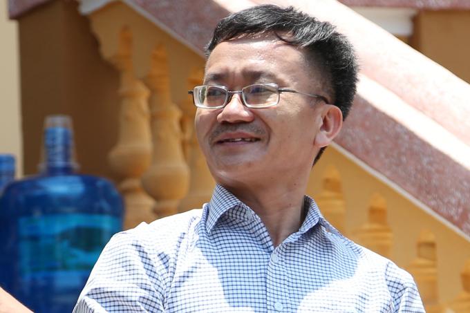 Bị cáo Nguyễn Quang Vinh rời tòa ngày 14/5. Ảnh: Phạm Dự.