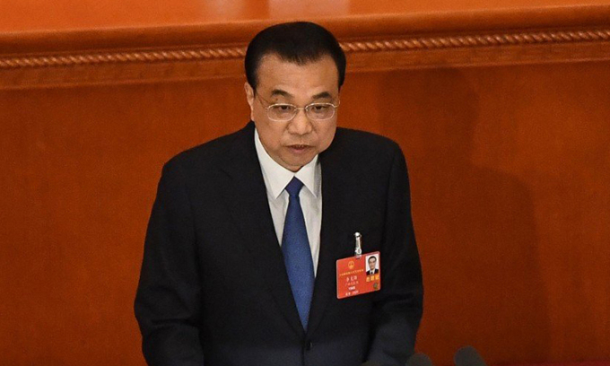 Thủ tướng Trung Quốc Lý Khắc Cường phát biểu trước quốc hội tại Đại lễ đường Nhân dân Bắc Kinh hôm nay. Ảnh: AFP.