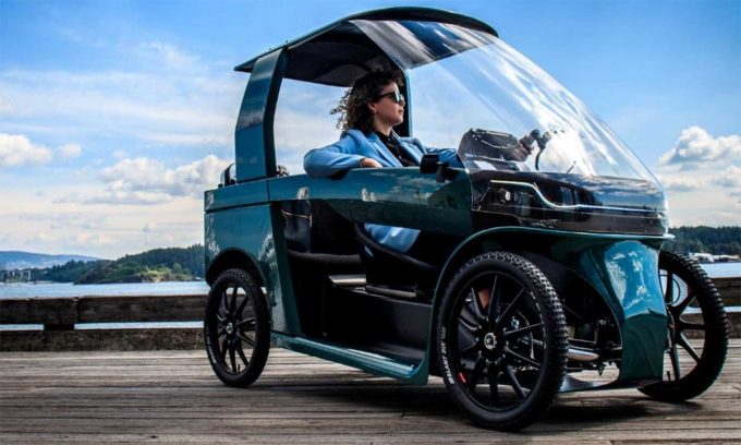 Car-eBike trông như một chiếc ôtô mini, nhưng là xe đạp điện bốn bánh. Ảnh: CityQ