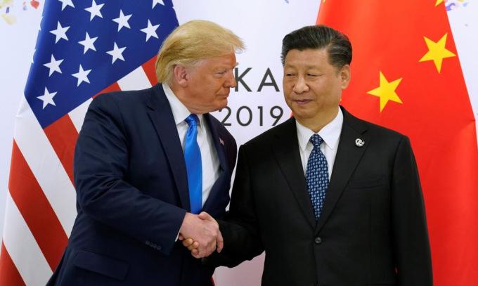 Tổng thống Trump (trái) và Chủ tịch Tập gặp nhau tại Nhật Bản năm 2019. Ảnh: Reuters.