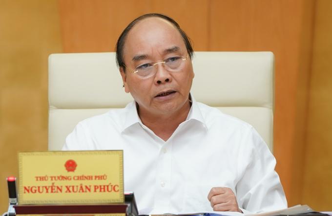 Thủ tướng Nguyễn Xuân Phúc chủ trì họp Thường trực Chính phủ về phòng chống Covid-19. Ảnh: Quang Hiếu
