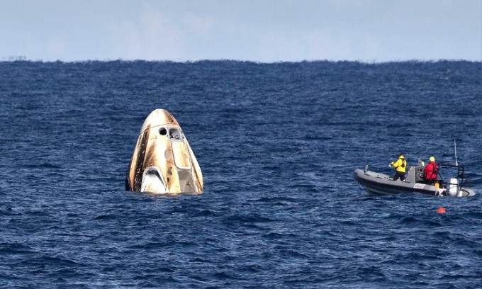 SpaceX ship carrying astronauts successfully landed at sea