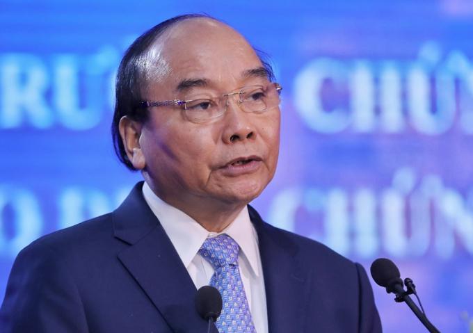 Thủ tướng Nguyễn Xuân Phúc phát biểu tại Lễ kỷ niệm 20 năm hoạt động thị trường chứng khoán Việt Nam tại TP HCM, sáng 20/7. Ảnh: Quỳnh Trần.