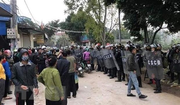 Lực lượng chức năng bảo vệ hiện trường hôm 9/1. Ảnh: TTXVN