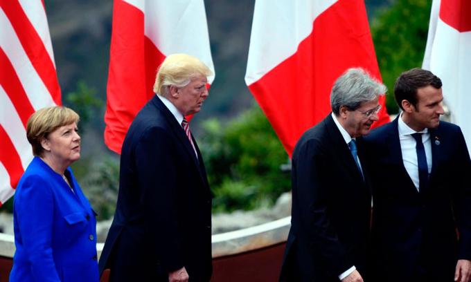Tổng thống Trump (thứ hai từ bên trái) cùng lãnh đạo Đức, Pháp và Italy chuẩn bị chụp ảnh kỷ niệm tại hội nghị G7 ở Taormina, Italy năm 2017. Ảnh: AFP.