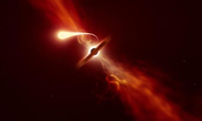 Minh họa ngôi sao bị hố đen kéo căng thành sợi mỏng trước khi nuốt chửng. Ảnh: M. Kornmesser/ESO.