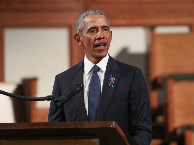 Cựu tổng thống Mỹ Obama phát biểu trong lễ tang nghị sĩ John Lewis ở Atlanta hồi tháng 7. Ảnh: AP