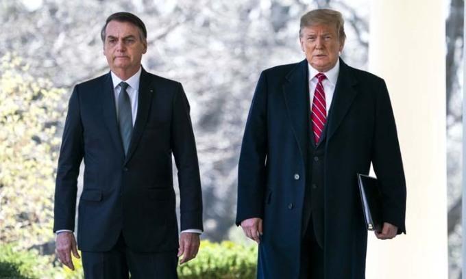 Tổng thống Mỹ Donald Trump (phải) và người đồng cấp Brazil Jair Bolsonaro tại Nhà Trắng hồi tháng 3/2019. Ảnh: AFP.
