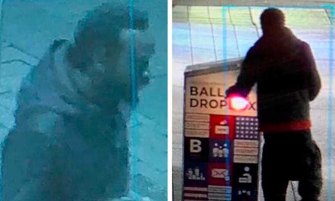 Người đàn ông xuất hiện gần thùng phiếu bị cháy ở Boston, Massachusetts, hôm 25/10. Ảnh: CBS Local.