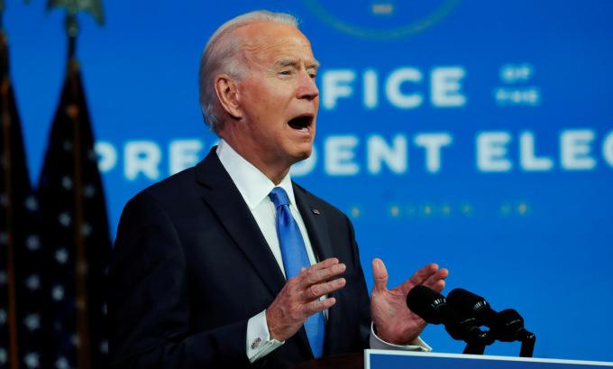 Biden phát biểu trước nước Mỹ tối 14/12. Ảnh: Reuters.