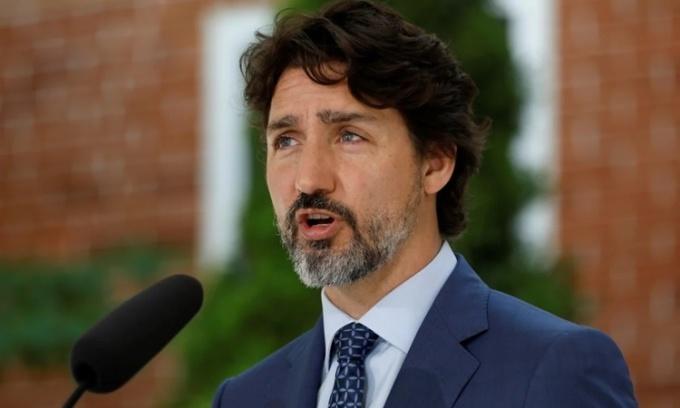 Thủ tướng Canada Justin Trudeau phát biểu tại một cuộc họp báo ở Ottawa ngày 14/12. Ảnh: Reuters.