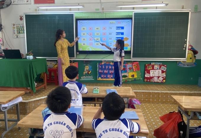 Học sinh trường Tiểu học Võ Văn Tần, quận 6, TP HCM trong buổi học ngày 20/1. Ảnh: Lê Nam