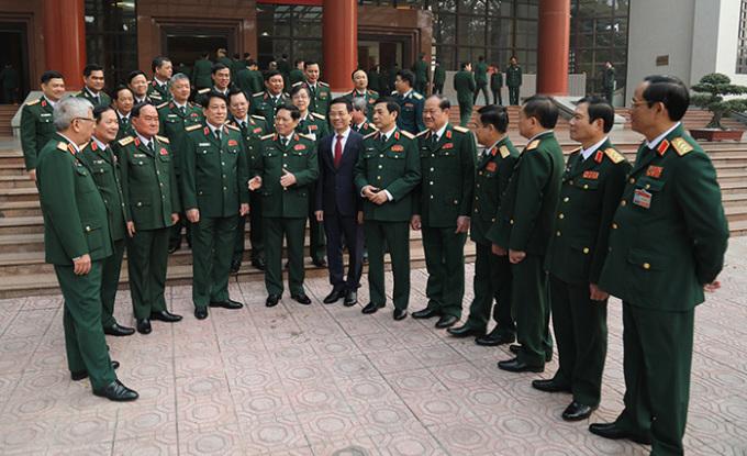 Đại tướng, Bộ trưởng Quốc phòng Ngô Xuân Lịch cùng các đại biểu dự cuộc gặp mặt. Ảnh: TTX