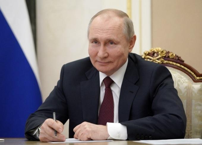 Tổng thống Nga Vladimir Putin trao đổi với ngườ dân Crimea qua liên kết video hôm nay, nhân kỷ niệm 7 năm sáp nhập bán đảo này. Ảnh: AFP.