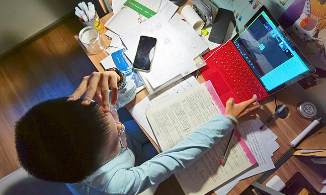 Trung Quốc giảm bài tập hè cho học sinh