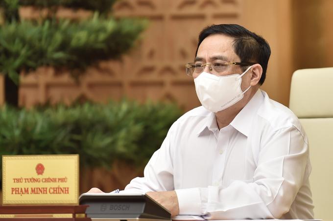 Thủ tướng Phạm Minh Chính chủ trì họp với tỉnh Bắc Ninh, Bắc Giang về các biện pháp phòng chống Covid-19, sáng 26/5. Ảnh: Nhật Bắc