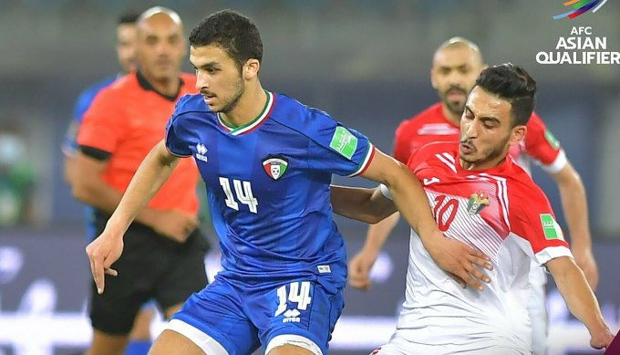 Kuwait (áo xanh) cầm hoà Jordan tối 11/6. Ảnh: AFC