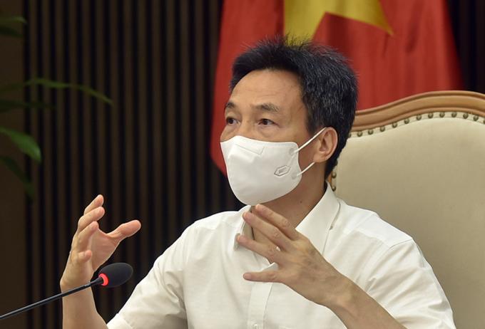 Phó thủ tướng Vũ Đức Đam chủ trì buổi làm việc với TP HCM về chống dịch. Ảnh: Đình Nam.