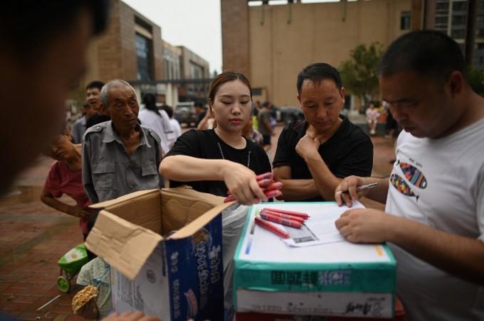 Ô tô chất đống ở Trịnh Châu sau trận đại hồng thủy