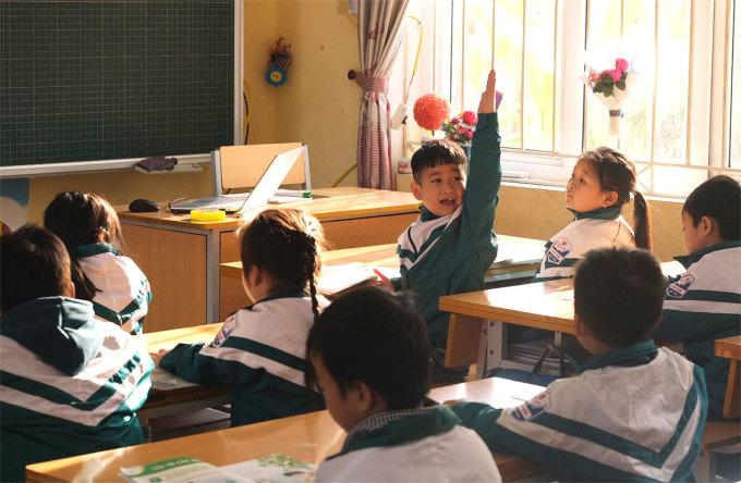Học sinh lớp 1 trường Tiểu học Bích Sơn (huyện Việt Yên, Bắc Giang) trong giờ học Tiếng Việt sáng 19/1. Ảnh: Dương Tâm.