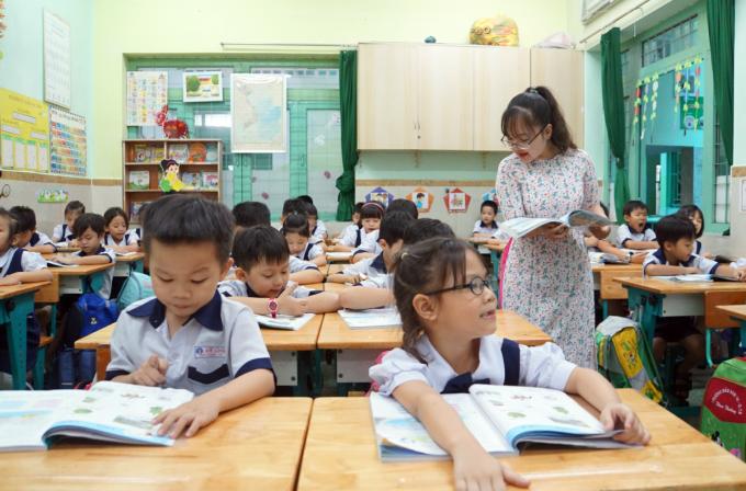 Một tiết học tiếng Việt lớp 1 trường Tiểu học Mê Linh (quận 3, TP HCM) hồi tháng 2. Ảnh: Mạnh Tùng