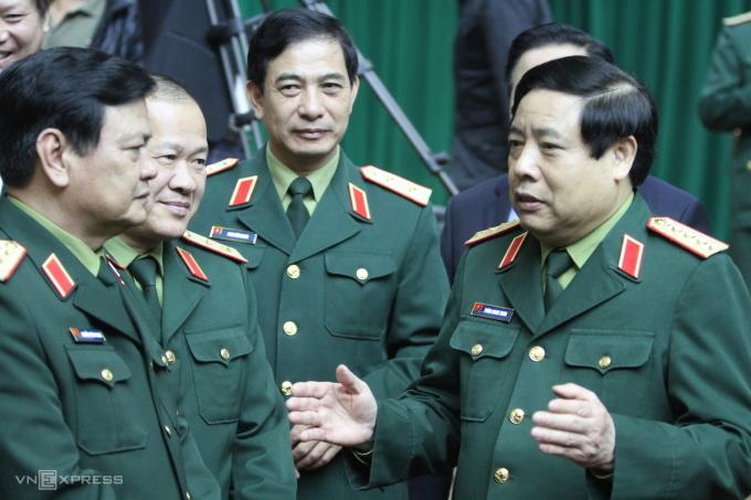 Đại tướng Phùng Quang Thanh (bìa phải) trong một hội thảo quốc gia về Quân đội tháng 12/2014. Ảnh: Võ Văn Thành