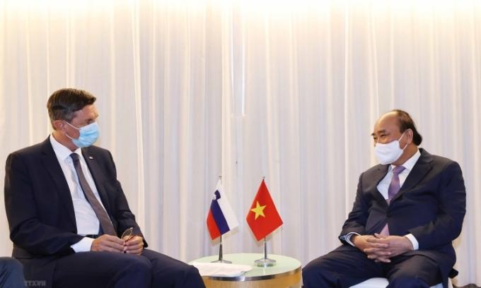 Chủ tịch nước Nguyễn Xuân Phúc (phải) gặp Tổng thống Slovenia Borut Pahor hôm 21/9. Ảnh: TTXVN.