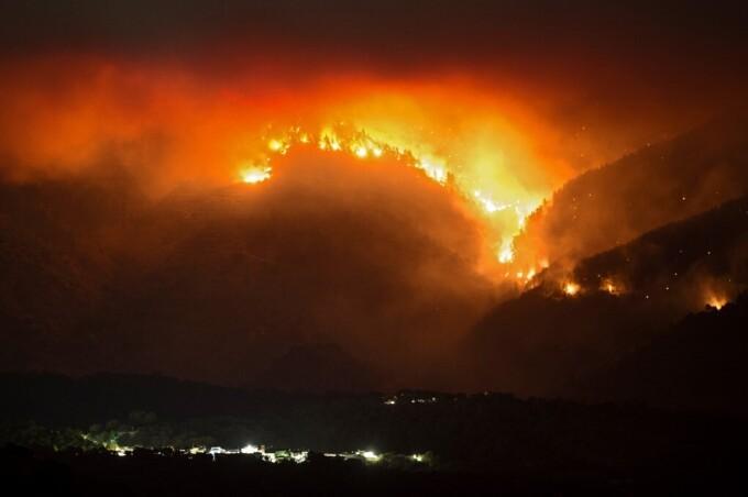 Một đám cháy rừng ở Tây Ban Nha hôm 12/9. Ảnh: AFP.