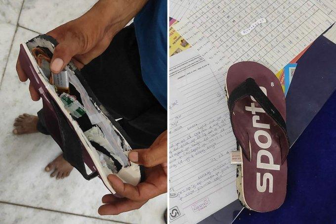 Thiết bị dùng để gian lận thi cử được phát hiện trong đế dép của thí sinh trong kỳ thi tuyển dụng tại bang Rajasthan, Ấn Độ hôm 25/9. Ảnh: AFP.